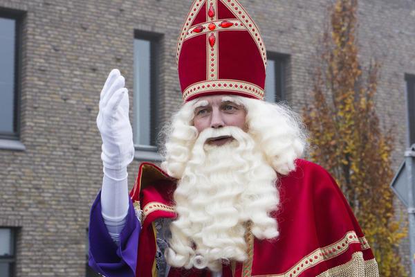 WINTERSWIJK, HOLLAND 16 NOVEMBER 2013: Santa Claus (Sinterklaas and Zwarte Piet) arriving in Winterswijk, The Netherlands  Mayabuns / Shutterstock.com