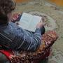 Или в удобном кресле с книгой.