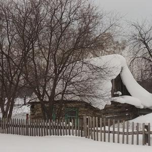 Домишко, укутанный снегом