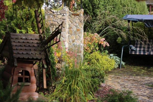 Мельница построенная мной 7 лет назад и арка из камня  построенная этой осенью.