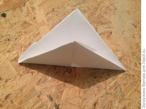 Еще раз загнуть в треугольник и потом вывернуть