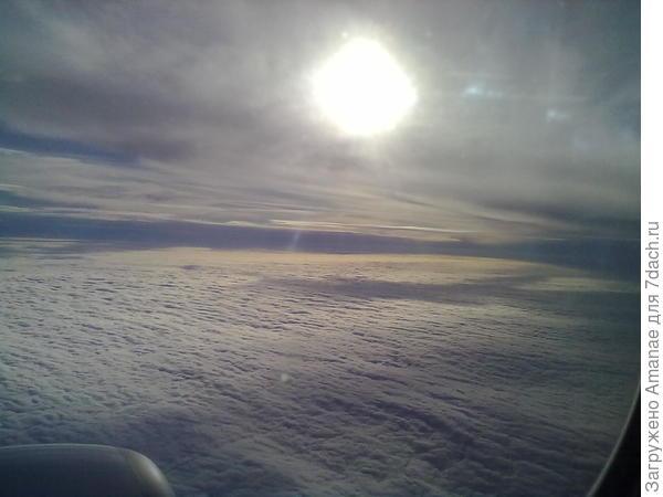 Над крылом самолёта, полёт из Орска в Москву 2014 год