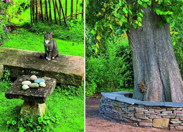 Плиты из песчаника с заброшенного сельского двора теперь с успехом заменяют садовую мебель. Да и кошке они по душе!