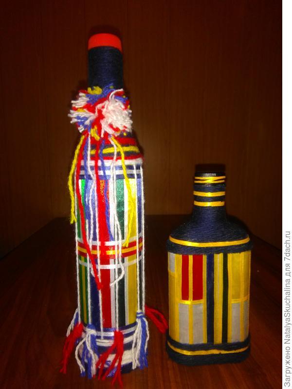 бутылочки еще оплела нитками и лентами